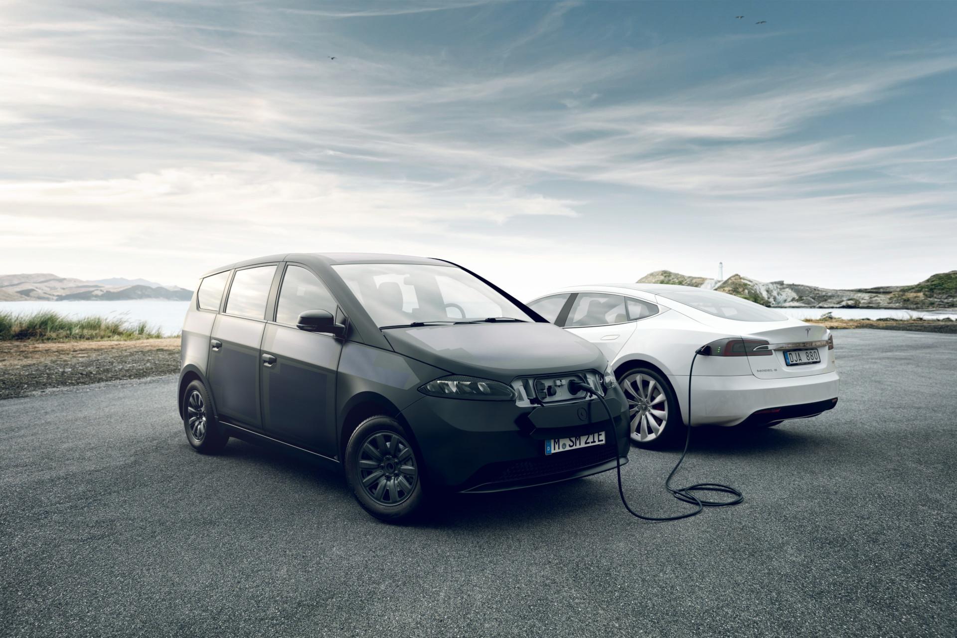 Sono Motors Sion charging a Tesla Model S